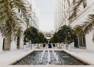 Outdoor wedding venue with palms, fountain and arches in Coral Gables